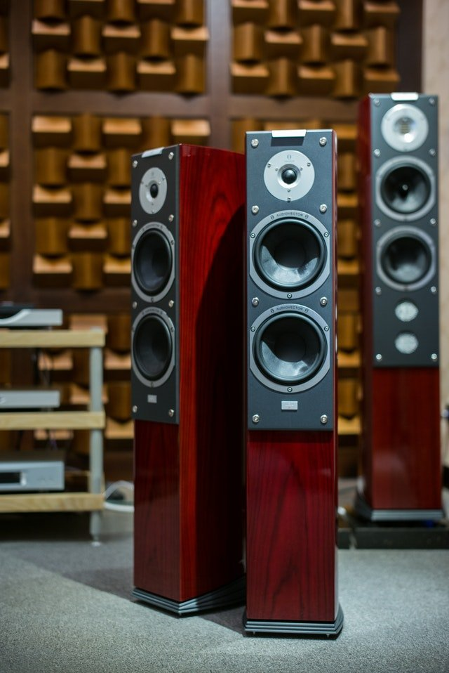 three red speakers